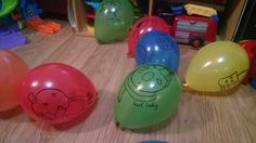 Balloons with sharpie drawn characters on.