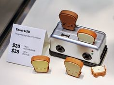 "We wish we had the whole set of genius 4 GB toast-shaped USBs for our office. ""Butta,"" ""Ry Ry,"" ""Crisp,"" and ""Tato"" fit into a toaster hub, which also includes an SD card reader and works with any flash drive. Pinterest Instagram, Hub Usb, Design Industrial, Have A Laugh, Designer Toys, You're Beautiful, Card Reader, Sd Card, Usb Flash Drive"