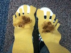 Hairy Hobbit feet made out of felt and elastic so they slip over your shoes.