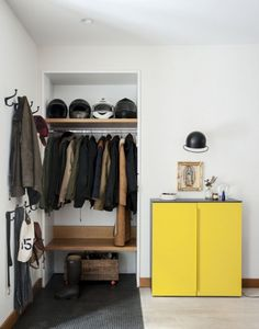 Entryway separated with rug or tile. Simple purpose built shelves. Just enough hanger space with hooks for guests. Landing strip with room for small vignettes.