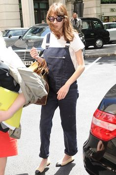 London - June 3 2013  Alexa Chung embraced fashion's new penchant for dungarees in a black denim pair.