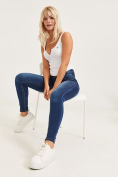 Exclusive piece from our EightyTwo Denim collection. 3 button and fly closure. Back pockets. Model is wearing size Ardene Mom Jeans, Skinny Jeans, Free Clothes, Jeggings, Spandex, Buttons, Denim, Model, How To Wear