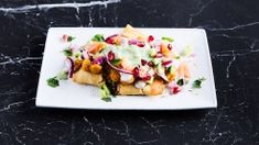 tasty mixed snack made from samosa, fresh vegetables and herbs, topped with various chutneys. Samosa Chaat, Stavanger, Lassi, Chicken Nuggets, Chutneys, Butter Chicken, Biryani, Naan, Fresh Vegetables