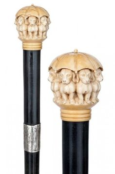 English Ivory Dachshund Cane - -- Ivory ball knob carved with eight dachshund under an umbrella, ebony shaft with wide and personalized silver wrap collar with London hallmarks, metal ferrule. Walking Sticks And Canes, Wooden Walking Sticks, Custom Canes, Cane Sword, Raising Canes, Cane Handles, Cane Stick, Wooden Canes, Umbrellas Parasols