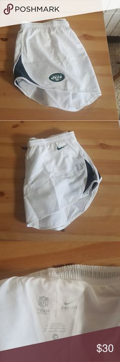 Nike Athletic Shorts Size Medium NWT. NY Jets white shorts. Slightly see through. With built in underwear. Green and white Nike and NY Jets logo. Gray fabric on side. Nike Shorts