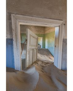 A beautiful collection of photos capturing a century-old abandoned town being swallowed by the sands in the African desert.