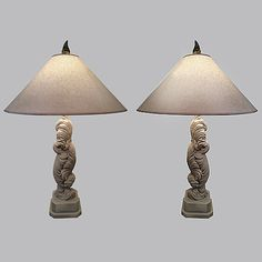 A pair of statuesque chalkware feather lamps from the 1940's.  A balanced combination of  elegance and fun to warm up any winter weary space. Image © Eclectisaurus. Visit our shop at 249 Gerrard St E, Toronto. 416-934-9009 www.eclectisaurus.com
