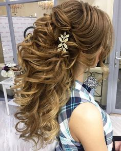 Beautiful wedding hairstyle for long hair perfect for any wedding venue