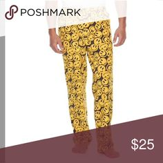Men's smile patterned lounge pants PRODUCT FEATURES Fun graphic Soft microfleece construction FIT & SIZING Elastic waistband FABRIC & CARE Polyester Machine wash B* 3.19 Pants