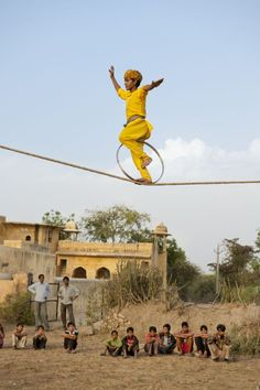 India, 2012, Indian child performs on a suspended rope - Steve McCurry