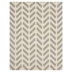 this hand-tufted wool rug, showcasing an eye-catching arrow motif in grey and ivory.