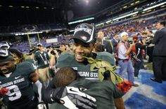 MSU's  Kurtis Drummond gets hugs as he celebrates with the rest of the Spartans after beating Ohio State 34-24 at the   Big Ten Championship football game Saturday 12/7/2013.   MSU will be heading to the Rose Bowl.