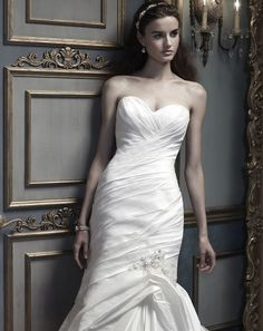 Amare Couture Style #B073 Silk Shantung trumpet silhouette with a sweetheart neckline. Ruched bodice is accented with pearls and rhinestones beaded applique.