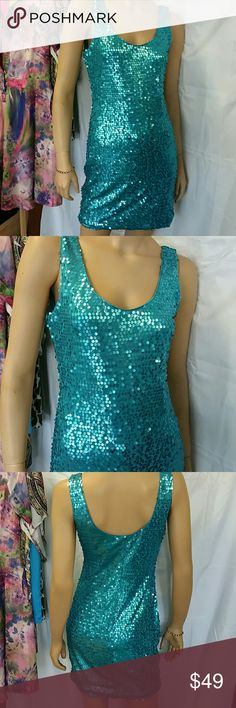 "Peacock blue party sequinned party dress. Med This is a beautiful color of blue. I call it peacock blue, completely sequinned tank style dress. Pulls on overhead, no zipper. Size Lg but fits like a med. Above the knee. Measures approx. 34"" in length, bust measures approx. 34/36"". This dress has no flaws to note. It is sure to turn heads at the club!! Stretchy and fully lined. As U Wish Dresses Mini"