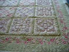 A combination of candlewicking and patchwork on this quilt.