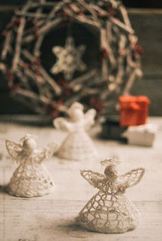 Christmas decoration, crocheted angels and wreath on the wooden board by Aleksandra Jankovic