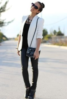 All black is brightened up with a vivid white blazer and a statement necklace. www.justblynk.com