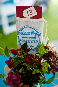 Carnival wedding, peanut bag table numbers wedding reception table centerpieces.