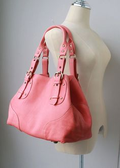 pink purse...oh my...this is sooooo great... lets see I would pair it with some white ankle jeans, pink sandals, and a lime green blouse and a gucci scarf...yes yes yes!!!!!