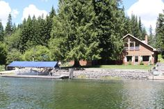 120' of deeded frontage on the Outlet to Priest Lake. Approximate 5minute boat ride on the Priest River to Outlet Bay and Priest Lake for allwater sports and activities. Comfortable 2 bedroom lake home with detached 2 c garage. Level lot with easy access. Boat dock with boat slip and pilings. Tastefully landscaped grounds with fruit trees, flower beds and a number of mature cedar evergreen trees to provide a parklike setting.Spacious half acre lot.