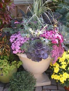 Fall Chalet Nursery planters with pansies, mums, kale, accent annuals, ornamental peppers and grasses