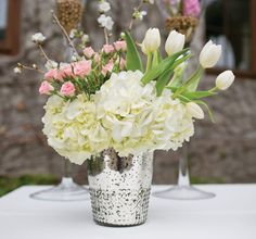 Glamorous Array glass floral vase in silver. Simply fill this silver vase with your favorite silk flowers and greenery to create an easy and colorful centerpiece arrangement for a touch of romantic glam at your vintage wedding! Colorful Centerpieces, Wedding Table Centerpieces, Wedding Decorations, Wedding Ideas, Post Wedding, Centerpiece Ideas, Wedding Stuff, Mercury Glass Decor, Mercury Glass Centerpiece