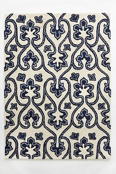 I love the Nestos rug from Anthropologie, but at $600 it was a bit high for our budget-friendly design.  I found a similar one at Home Goods for $99!