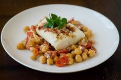 foil-baked fish with chickpeas, feta, and roasted tomatoes