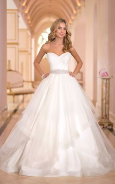 Modern princess Tulle wedding dress ballgown features a number of sweet details, such as crisscross ruching. Exclusive princess wedding dresses by Stella York.