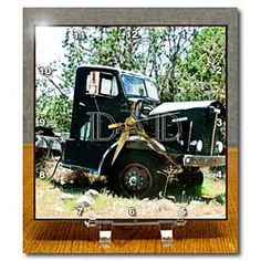An old truck with the word Dad on the side horizontally Desk Clock