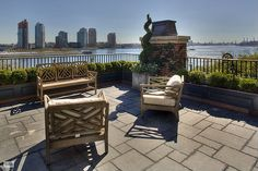 A brilliantly planted rooftop garden decked in Brazilian ipe wood is an ideal location for sunset vistas of the Midtown cityscape, East River and beyond. #NYC #patio #landscape
