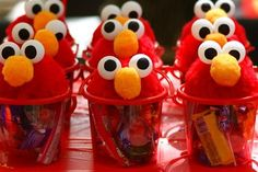 elmo birthday party  Hi! I got the plain buckets… Then made the faces with half unicel balls covered in the red fur fabric (i think we pasted with hot glue)… Then adden the eyes made from pinpon balls… For the noses we used yellow pom poms …. Good
