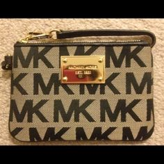"""Sunday SALE!! NWOT Michael Kors wristlet Sunday SALE!!!! HOST PICK!!!! 2/27/15- for """"night out party""""!!!!  New with out tags- Michael Kors canvas/beige with black lettering & black leather trim small wristlet.  Also has metal hardware on the front.  Approx 6 1/2"""" in length & 4"""" in height. Michael Kors Bags"""