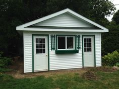 Shed/ Bunkie with white vinyl siding. www.builditoutback.ca