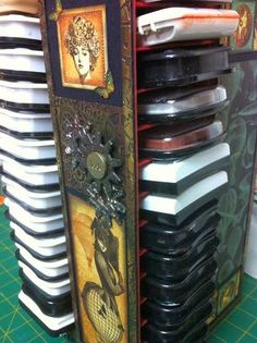 Ink & Reinker Storage Unit made completely from chipboard and lots of glue! Embellished with Graphic 45's Steampunk Debutante papers! It holds 56 ink pads (Ranger Archival, Memento, StazOn, VersaFine,ColorBox) and 50 reinkers!