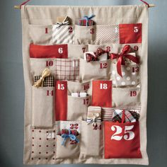 Kids Holiday Decor: Kids Chambray Christmas Advent Calendar - All Shapes Advent Calendar. A place for everything and everything in its place. That's what makes this calendar so unique. Pockets of different shapes and sizes make the perfect fit for a special treat each day. Details, details - Nod exclusive - Includes 25 pockets printed in numerical order with red and white ink - Pockets are perfect for holding holiday treats or special messages - Includes unfinished wooden dowel and cord for…
