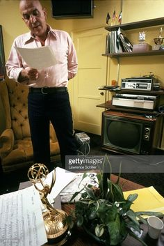 In his dressing room, American actor Telly Savalas (1922 - 1994) reads a script during the production of an episoide of his television show 'Kojak' (in which he played the titular character), Los Angeles, California, 1973.