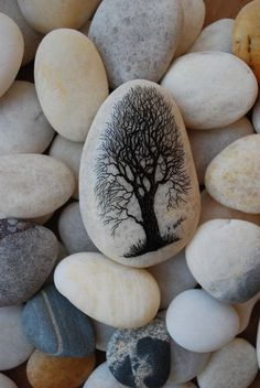 Hand-painted tree on beach stone