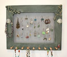 Re-purpose an old picture frame to make a jewelry holder. Attach pegs to the front for necklaces/bracelets, and chicken wire to the back for earrings. I've also seen dowels across the middle instead of chicken wire. Cute.