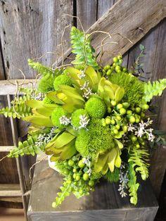 button mums, leucadendron, hypericum, green trick dianthus and sword fern - green bouquet