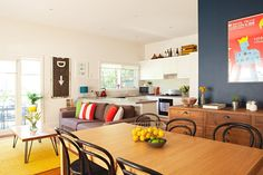 Living room // dining room // kitchen // open concept // Jen and Kirstie's Happy, Colorful Home in Australia