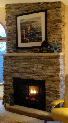 East wall or South wall? With local briar hill stacked stone--straight up, no mantle ledge, then a mantle made of a re-purposed beam?