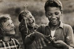 The Loving Children: Peggy, Sidney, and Donald Loving playing, King and Queen County Virginia. April 1965
