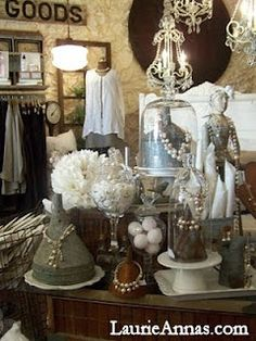 Funnels, chicken coops, old signs, and lots of chandies, all part of our clothing and jewelry displays at the Shoppe!