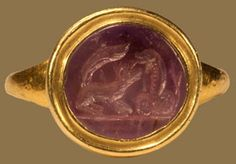 Mongoose fighting a cobra amethyst intaglio. Ancient Rome, 3rd century? Amethyst and gold.