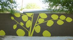 Here's an outdoor mural I painted on a cinderblock wall, inspired by an out door mural I saw in Los Angeles. Facebook/RomiCortierFineArt
