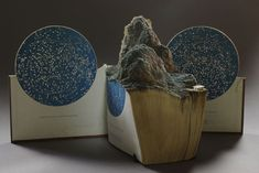 Guy Laramee - carved constellation book art