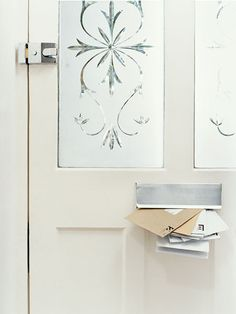 Mimic the Look of Etched Glass: Acid-etched glass—which became popular in the mid-1800s as a way to shield bar patrons from view—elevates a plain front door.