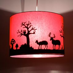 Cut out your desired shapes out of black foam or paper and glue inside the lamp.. voila!
