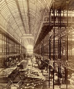 'The Nave From The North End - Commencement Of Monti's Fountain' Construction work in progress at the nave of the Crystal Palace Exhibition Hall in Sydenham. Photograph by Philip Henry Delamotte - 1855